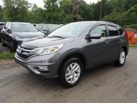 This 2015 Honda CR-V EX is complete with top-features