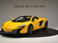 This is a McLaren 650S for sale by Miller Motorcars.