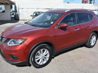 Presented in stunning Red. our 2015 Nissan Rogue SV SUV