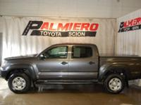 This 2015 Toyota Tacoma in Magnetic G features: 4WD
