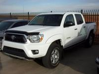 This outstanding example of a 2015 Toyota Tacoma TRD