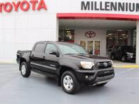 This outstanding example of a 2015 Toyota Tacoma 4WD