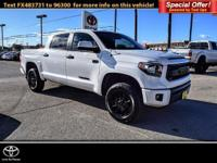SUPER WHITE exterior and BLACK interior, TRD Pro trim.