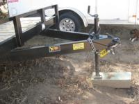 New (used only once) 18 foot flat bed trailer, black,