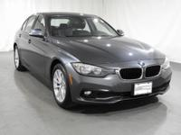 2016 BMW 3 Series 320i xDrive  in Mineral Grey. Driver