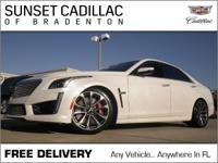 CTS-V, with less than 12k miles, pretty much brand