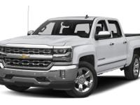 2016 Chevrolet Silverado 1500 LTZ in White vehicle