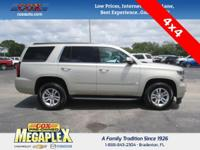 This 2016 Chevrolet Tahoe LT in Champagne Silver