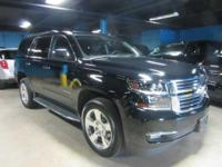 This certified pre-owned 2016 Tahoe LTZ features black