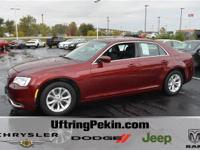This is a 2016 Chrysler 300 Limited with only 11K miles