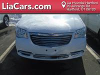 2016 Chrysler Town & Country in Bright White.