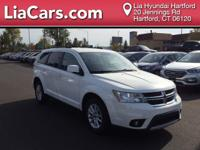 2016 Dodge Journey in White. AWD. Squeaky clean, one