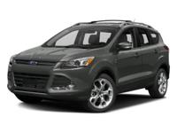 2016 Ford Escape Titanium in White. Low miles indicate