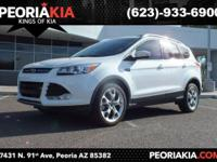 This is a 2016 Ford Escape Titanium model. It has a