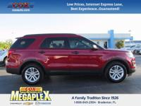 This 2016 Ford Explorer in Ruby Red Metallic Tinted