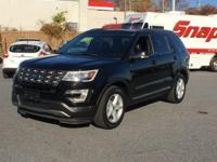 THIS FORD EXPLORER XLT COMES WITH A PANORAMIC SUNROOF,