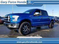 This 2016 Ford F-150 XLT, has a great Blue exterior,