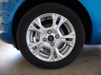 This car features: **BLUETOOTH**, **MP3**, Fiesta SE,