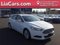 2016 Ford Fusion Hybrid in Oxford White, Back Up