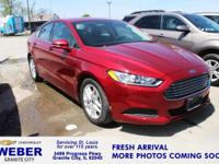 Recent Arrival! Red Ford Fusion  Odometer is 2667 miles