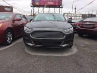 Drive away with this beautiful 2016 Ford Fusion. Down