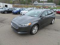 Our 2016 Ford Fusion SE is stunning in Magnetic! Under