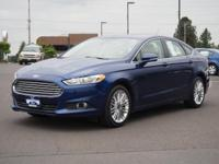 This BRIGHT BLUE 2016 Ford Fusion SE might be just the