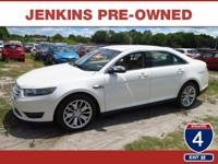 This 2016 Ford Taurus Limited, has a great White