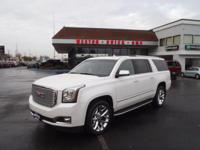 This WHITE FROST 2016 GMC Yukon XL Denali might be just