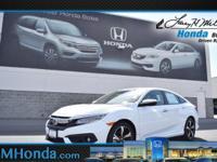 Grab a deal on this 2016 Honda Civic Sedan Touring