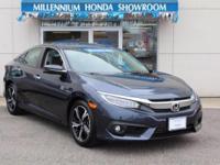 This Honda Certified Civic Sedan 4dr CVT Touring is