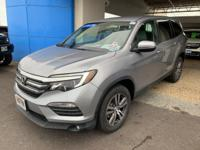 This 2016 Honda Pilot EX is proudly offered by Big