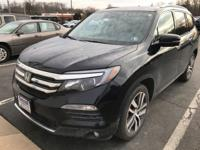 This outstanding example of a 2016 Honda Pilot Touring