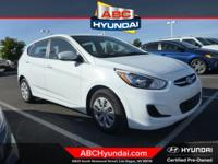 Beige w/Cloth Seat Trim, ABS brakes, Electronic