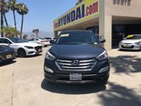 This outstanding example of a 2016 Hyundai Santa Fe
