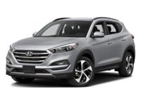 This 2016 Hyundai Tucson Limited in Ruby features: