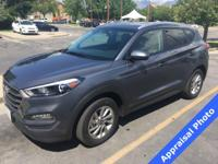 This Tucson SE is a CARFAX 1-Owner, has a 100,000 mile