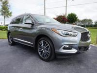 This 2016 INFINITI QX60 is featured in Graphite Shadow