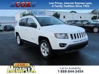 This 2016 Jeep Compass Sport in Bright White Clearcoat