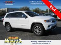 This 2016 Jeep Grand Cherokee Limited in Bright White