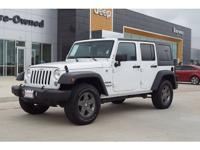 This WHITE 2016 Jeep Wrangler Unlimited 4D SUV 4WD