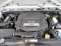 Scores 20 Highway MPG and 16 City MPG! This Jeep