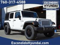Come see this 2016 Jeep Wrangler Unlimited SPOR. Its