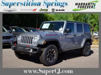 Silver 2016 Jeep Wrangler Unlimited Rubicon 4WD 5-Speed