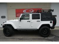 Completely Customized Wrangler Unlimited Sahara.