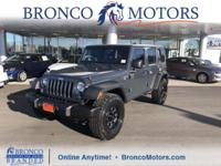 Grey 2016 Jeep Wrangler Unlimited Sport 4WD 5-Speed