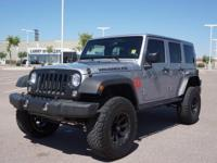 This 2016 Jeep Wrangler Unlimited Black Bear features