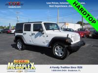 This 2016 Jeep Wrangler Unlimited Sport in Bright White