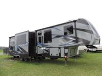 This 371 Keystone Fuzion toy hauler fifth wheel is