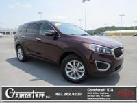 This 2016 Kia Sorento L, has a great Dark Cherry
